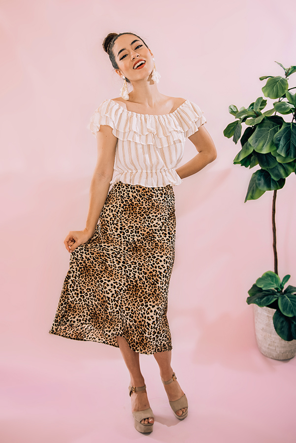 """BROWN LEOPARD PRINT MIDI SKIRT WITH ELASTIC WAIST. MODEL INFO: PIPER – SIZE 0, 5'5"""" WEARING A SMALL.  100% POLYESTER SMALL 0-2 MEDIUM 4-6 LARGE 8-10"""