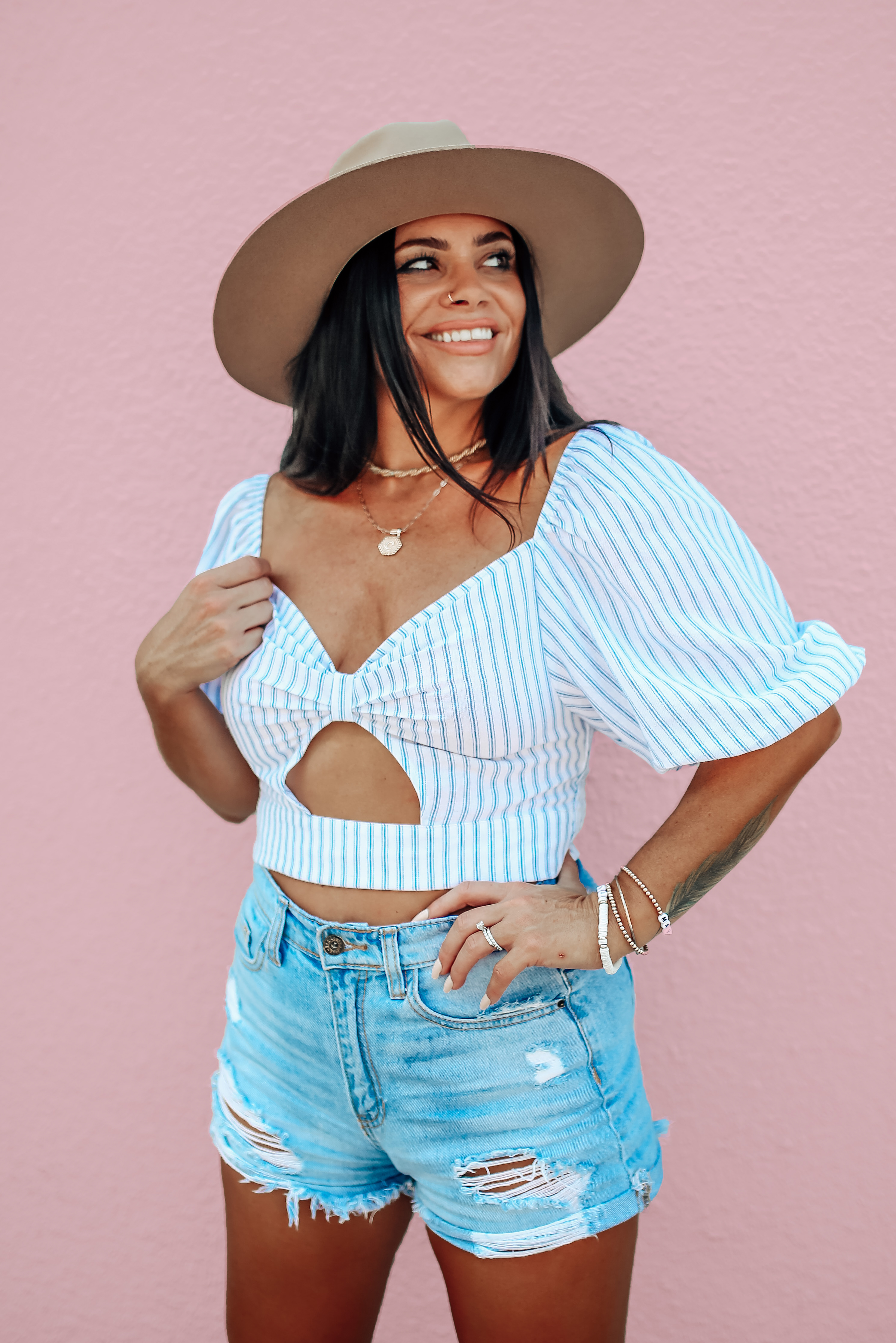 """MAVERICK EXCLUSIVE! WHITE AND BLUE STRIPED CROP TOP. PUFF SLEEVES CAN BE WORN ON OR OFF SHOULDERS. KEYHOLD FRONT DETAIL. STRETCHY ELASTIC RUCHED BACK. 100% COTTON. AMANDA IS 5'7"""" A SIZE 2, WEARING A SMALL. S 0-4 M  4-8 L 8-10"""