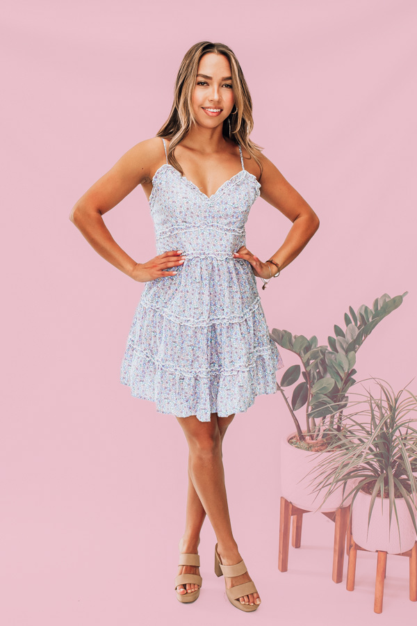 PASTEL FLORAL PRINT. V NECK WITH SMALL RUFFLE DETAILS. ADJUSTABLE SPAGHETTI STRAPS. ELASTIC RUCHING AROUND THE BACK. MATERIAL IS NOT STRETCHY. AMANDA IS A SIZE 2, WEARING A SMALL. DALLAN IS A SIZE 4, WEARING A SMALL. 100% POLYESTER. S 0-4 M 4-8 L 8-12