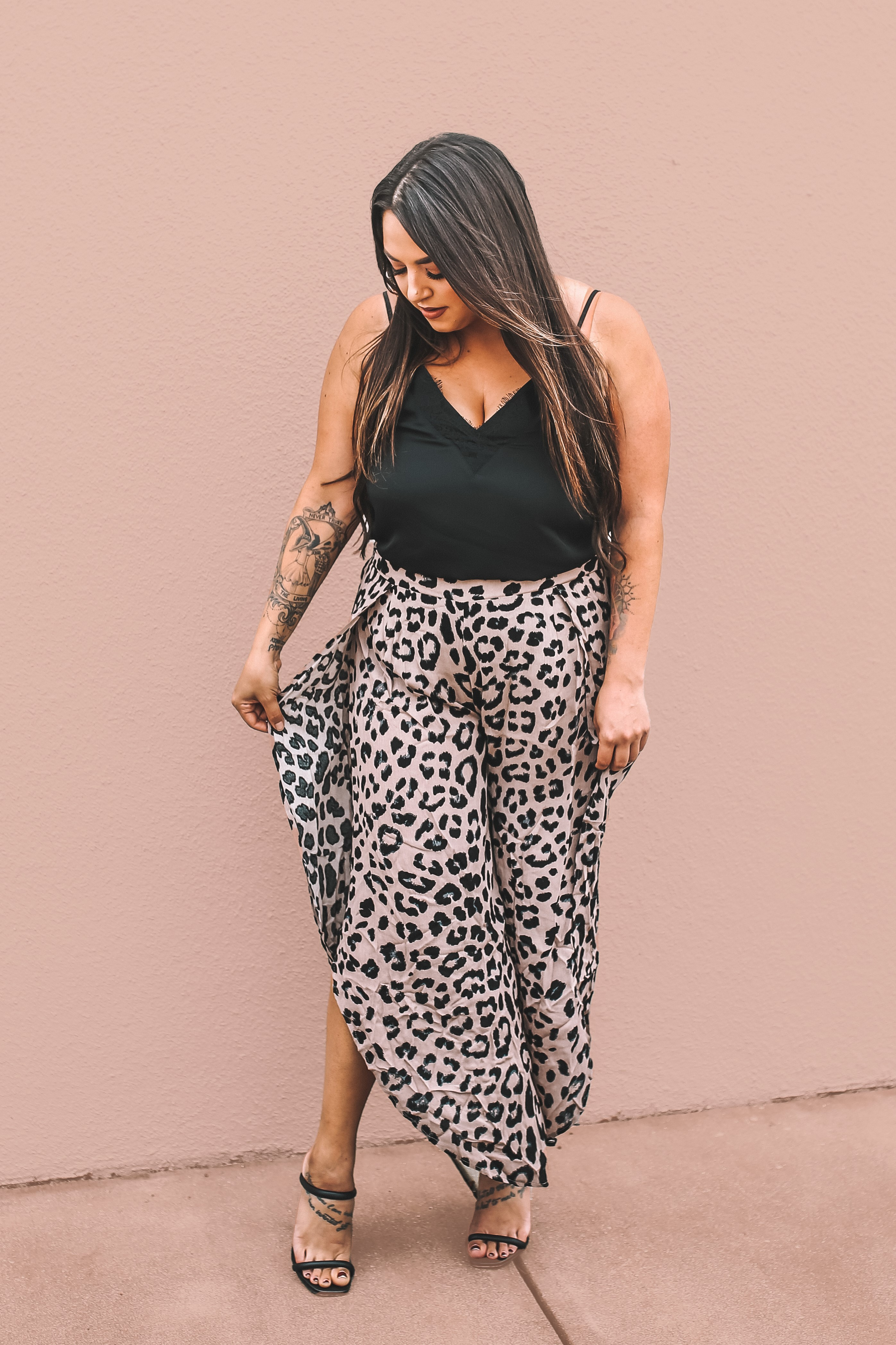 """MAVERICK EXCLUSIVE! WIDE LEG LEOPARD PANTS, WITH SLITS AT SIDES. EXTRA FABRIC ADDED TO ENSURE NO OPENINGS AT TOP OF LEG. 27in. INSEAM AT LONGEST POINT. 100% RAYON. AMANDA IS 5'7 SIZE 2, WEARING SMALL. GABBY IS 5'8"""" A SIZE 12 WEARING AN X LARGE."""