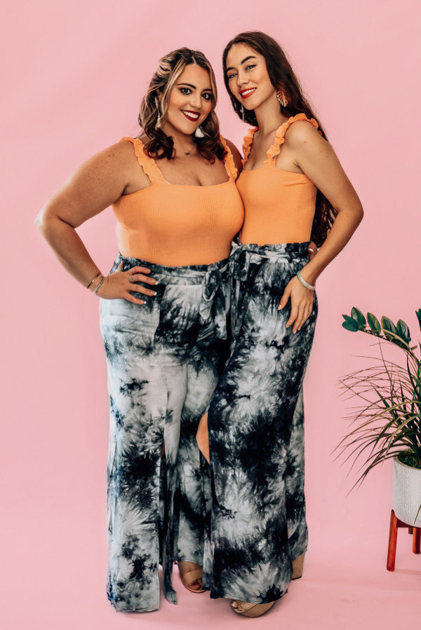 BLUE TIE DYE, WIDE LEG, OPEN SLIT PANT. HIGH WAISTED WITH A BELT SASH. 100% RAYON. PIPER IS 5'4, SIZE 0 WEARING A SMALL. NIKI IS SIZE 14, WEARING A LARGE.  S  0-4 M  6-10 L 10-14