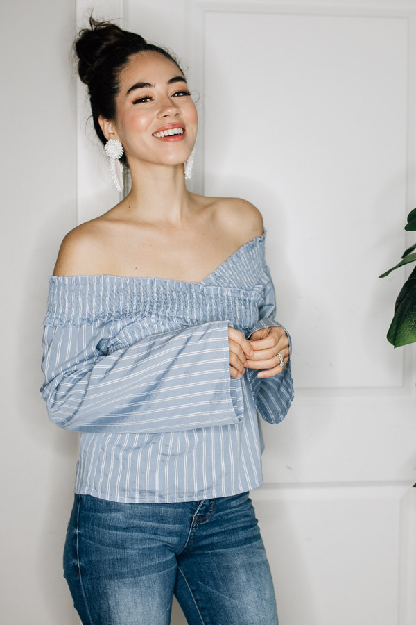STRIPED, OFF THE SHOULDER TOP WITH SHORTER WAIST AND ELASTIC AT SHOULDERS AND BUST. 100% POLYESTER.  X-SMALL 0-2 SMALL 4-6 MEDIUM 8-10 LARGE 12-14 X-LARGE 16-18