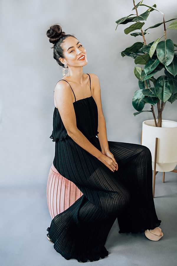 """BLACK, SLEEVELESS PLEATED JUMPSUIT WITH ELASTIC WAISTBAND AND ADJUSTABLE STRAPS. LINED WITH SHORTS. MODEL INFO: PIPER - SIZE 0, 5'5"""" AND WEARING A SMALL. NIKI - SIZE 14, 5'4"""", WEARING A LARGE. 100% POLYESTER SMALL 4-6 MEDIUM 8-10 LARGE 10-12"""