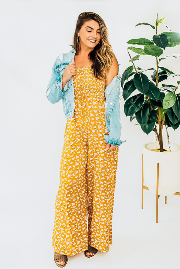 MUSTARD YELLOW, WIDE LEG JUMPSUIT WITH THIN STRAPS. RUNS A LITTLE SMALL. PIPER IS A SIZE 0 AND WEARING A SMALL. SISSY IS A SIZE 6 AND WEARING A LARGE. 100% RAYON  X-SMALL 0-2 SMALL 2-4 MEDIUM 6-8 LARGE 8-10 X-LARGE 10-12