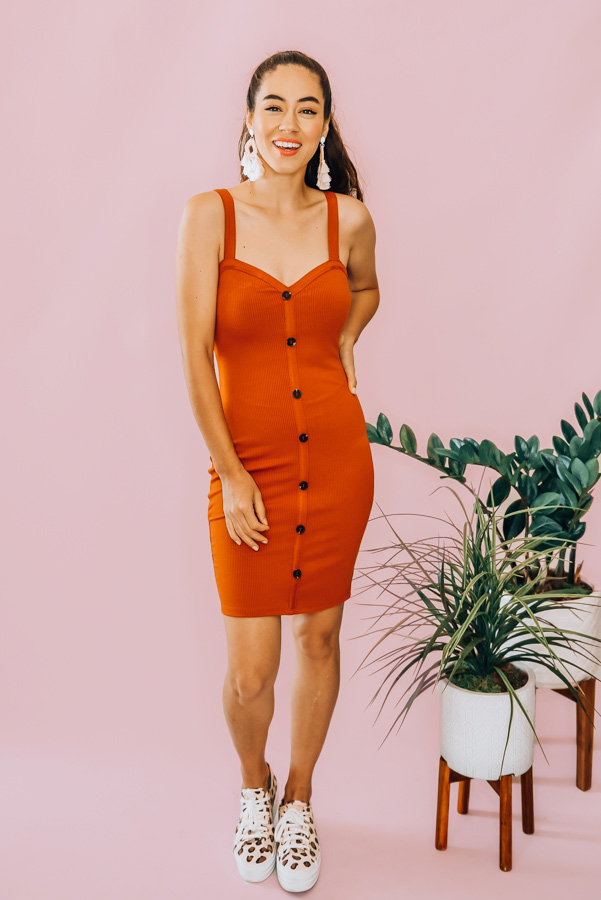 RUST, RIBBED BODYCON DRESS. BUTTON DOWN DETAIL AND HEART NECK. COMES IN THREE COLORS – BLACK, RUST, AND HOT PINK. 88% RAYON, 12% SPANDEX. PIPER IS 5'4 SIZE 0, WEARING A SMALL. NIKI IS SIZE 14, WEARING A LARGE.  S 0-4 M 6-10 L 12-16