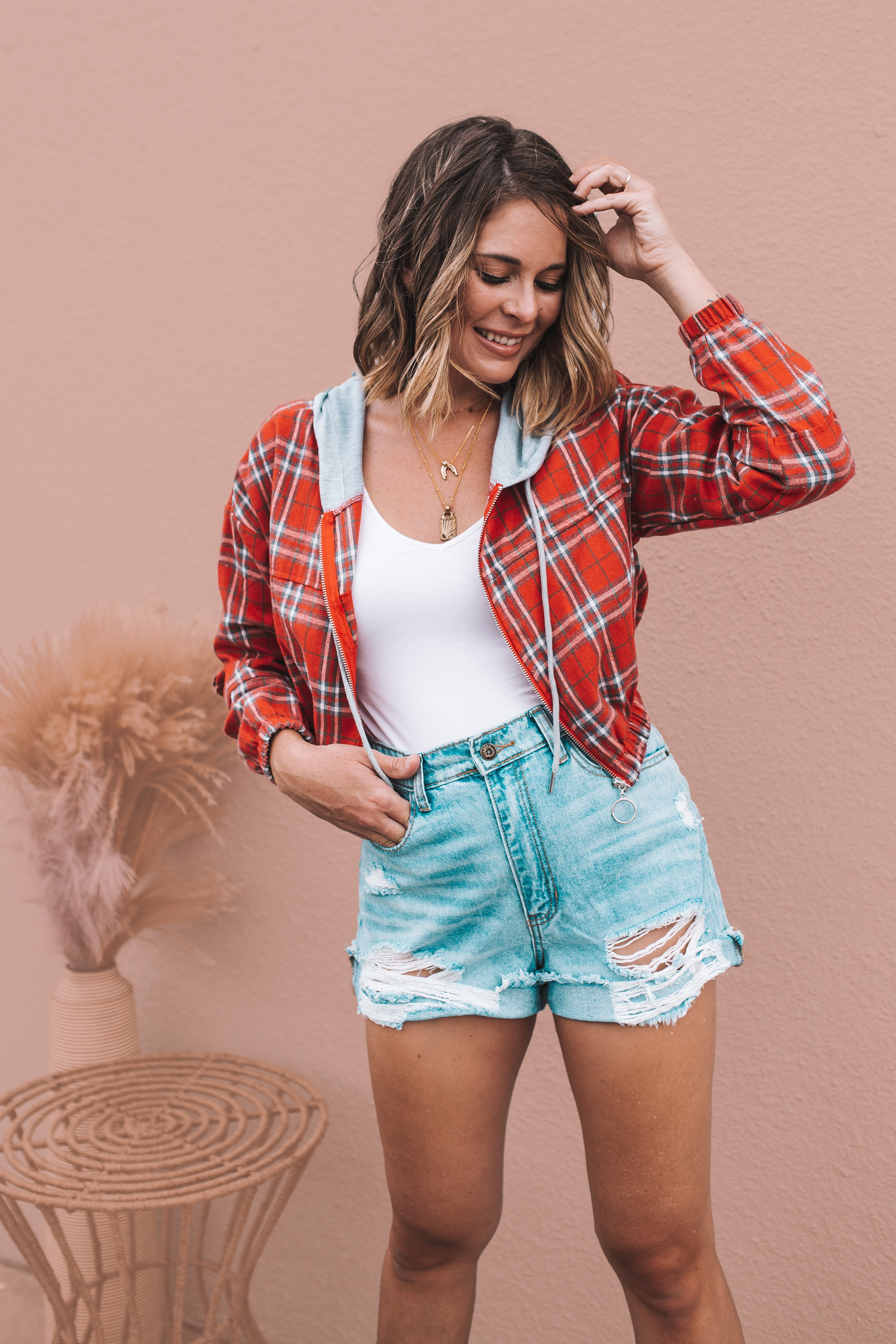 RED PLAID, LIGHTWEIGHT JACKET WITH ELASTIC CUFFS AND WAIST. CROPPED FIT. GREY HOOD WITH DRAWSTRING. ZIP-UP FRONT. 80% COTTON, 20% POLYESTER. AMANDA IS 5'7 SIZE 2, WEARING A SMALL. GABBY IS SIZE 10/12 WEARING A LARGE. S 0-4 M 4-8 L 8-12