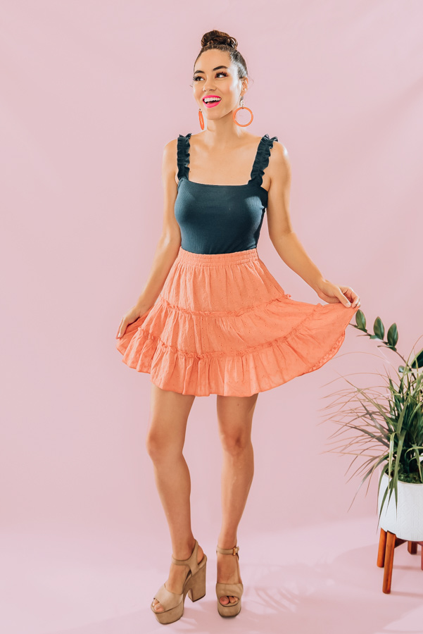 ORANGE-COLORED, EYELET, LAYERED AND RUFFLED SKIRT. ELASTIC WAIST AND LINED. 100% COTTON. PIPER IS 5'4, IS A SIZE 0 WEARING A SMALL.  S 0-4 M 4-8 L  8-12