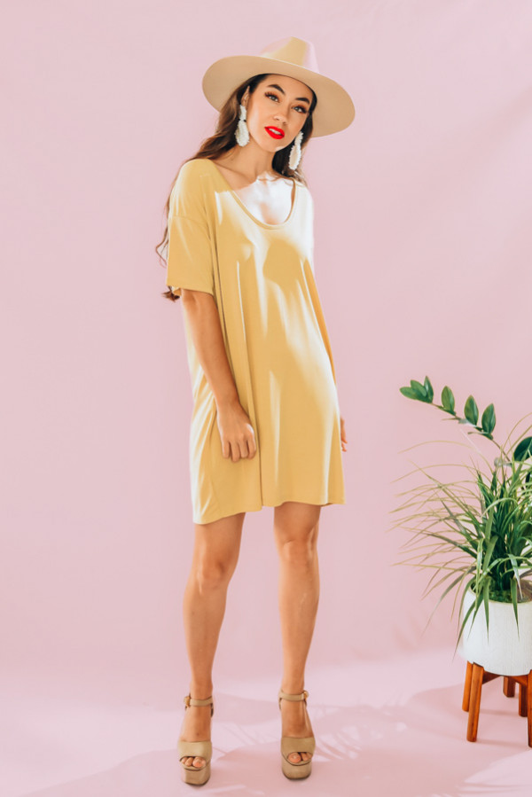 MANGO-COLORED, LOOSE FITTING SCOOP NECK DRESS. 63% MODAL, 37% POLYESTER. PIPER IS 5'4, SIZE 0 WEARING A SMALL. NIKI IS A SIZE 14, WEARING A SIZE SMALL AS A TOP, LARGE WAS TOO SHORT FOR A DRESS. S 0-6 M 6-12 L 12-18