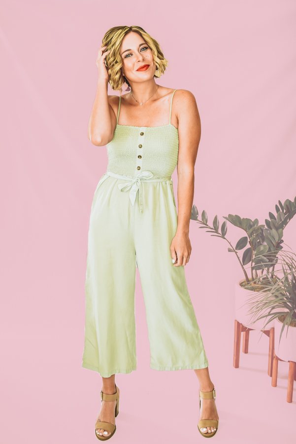 SAGE GREEN, SEMI CROPPED LENGTH ROMPER. ADJUSTABLE SPAGHETTI STRAPS, VERY STRETCHY ELASTIC RUCHING TOP WITH NONFUNCTIONAL BUTTONS DOWN THE BUST. REMOVABLE TIE WAIST. LEG MATERIAL HAS NO STRETCH. 100% TENCEL. S 0-4 M 6-8 L 10-12