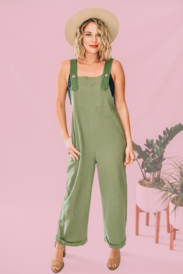 OVERSIZED BOHO LOOK, LIGHTWEIGHT CREPEY MATERIAL. STRAPS FEATURE EBROIDERED OVERLAY WITH WOOD BUTTONS. POCKET ON FRONT AND FUNCTIONAL SIDE POCKETS. WIDE LEG WITH CUFFED BOTTOM. 100% COTTON. S 0-6 M 6-10 L 10-14 XL 14-16